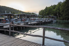 Pleasure boats on the pier in the Plitvice Lakes national park. Royalty Free Stock Image