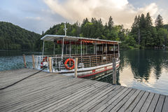 Pleasure boats on the pier in the Plitvice Lakes national park. Royalty Free Stock Photography