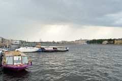 Pleasure boats on the river Neva. Royalty Free Stock Photo