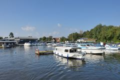 Pleasure Boats on  River Yare centre for tourism on Norfolk Broads. Wroxham Norfolk  , United Kingdom - October 25, 2016: Pleasure Boats on  River Yare centre Royalty Free Stock Images