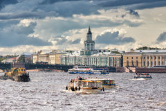 Pleasure boats sail along the Neva River against of the Kunstkammer building in St. Petersburg Royalty Free Stock Photos