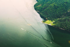 Pleasure boats are sailing between fjords. Amazing nature of the Stock Photography