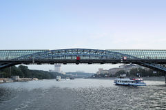 Pleasure boats, sailing on the Moscow River under the St. Andrew (Pushkin) bridge Stock Image