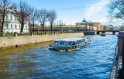 The pleasure boats in St Petersburg. The pleasure boats are the famous tourist attraction in city, Krukov Canal, St Petersburg, Russia Royalty Free Stock Image