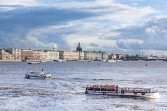 Pleasure boats. ST. PETERSBURG, RUSSIA - JULY 20, 2017: Pleasure boats in the water area of the Neva River and Beautiful clouds Royalty Free Stock Images