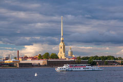 Pleasure boats. ST. PETERSBURG, RUSSIA - JULY 20, 2017: Pleasure boats in the water area of the Neva River, Peter and Paul Fortress in St. Petersburg and Royalty Free Stock Photo