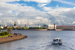 Pleasure boats. ST. PETERSBURG, RUSSIA - JULY 20, 2017: Pleasure boats in the water area of the Neva River, Spit of Vasilyevsky Island and Beautiful clouds Royalty Free Stock Photos