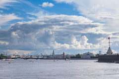 Pleasure boats. ST. PETERSBURG, RUSSIA - JULY 20, 2017: Pleasure boats in the water area of the Neva River, Spit of Vasilyevsky Island and Beautiful clouds Royalty Free Stock Image