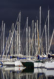 Pleasure boats by a stormy day. Pleasure boats docked in a marina by a stormy day. France, mediterranean coast Stock Image