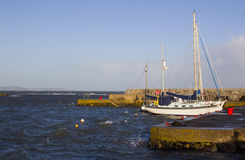 Pleasure boats on their moorings at Groomsport Harbor during a winter storm Stock Images