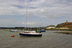 Pleasure boats on their moorings in the historic Bosham Harbour in West Sussex in the South of England stock photo