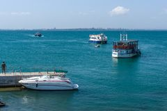 Pleasure boats with tourists in the Burgas Bay. Bulgaria. Stock Photography