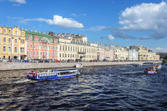 Pleasure boats with tourists on the Fontanka River in St. Peters Stock Photo