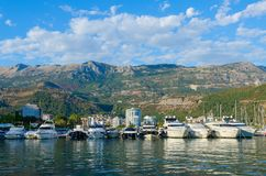 Pleasure boats and yachts at pier on promenade of Budva, Montenegro Royalty Free Stock Images