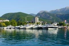 Pleasure boats and yachts at pier on promenade of Budva, Montenegro Royalty Free Stock Photo