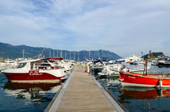 Pleasure boats and yachts at pier on waterfront, Budva, Monteneg Stock Image