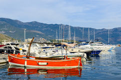 Pleasure boats and yachts at the pier on the waterfront of the r Royalty Free Stock Photography