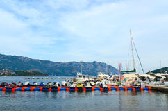 Pleasure boats and yachts at the pier on the waterfront of the r Stock Image