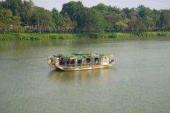 Pleasure catamaran floats on the Fragrant river. Hue, Vietnam royalty free stock images