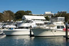Pleasure Craft. Pleasure cruisers berthed in Nelson Bay Harbour, Port Stephens, New South Wales, Australia Stock Photo