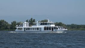 Pleasure cruise boat traveling the river Royalty Free Stock Photos