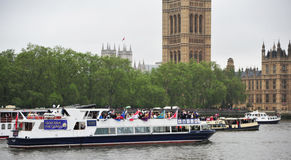 Pleasure cruisers Diamond Jubilee Pageant. Pleasure cruisers sail past Houses of Parliament in London on June 3rd during the Royal Pageant, part of the Diamond Royalty Free Stock Photo