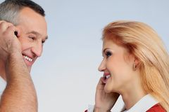 Pleasure of dialogue. Closeup  portrait of smiling men and  women  talking by mobile phones Stock Image