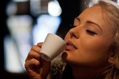 Pleasure of drinking a coffee Royalty Free Stock Images