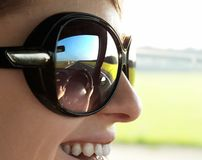 Pleasure of driving. Girl driving car with reflection in glasses royalty free stock photos