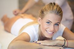Pleasure and enjoyment. Woman on ant cellulite massage treatment. Close up. Copy space. Looking at camera. Focus on woman stock photo
