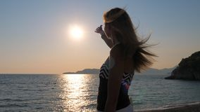 Free Pleasure Female Hands Catch The Sun In The Sky Standing On Coast Sea Stock Photography - 109194462