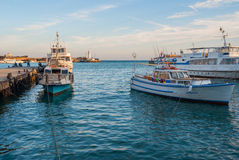 Pleasure  and fishing boats are waiting for the tourists Royalty Free Stock Photography
