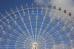 The pleasure ground. The ferris wheel in the pleasure ground Royalty Free Stock Photo