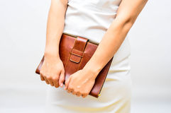 Pleasure of learning. Female hands holding brown leather notebook on white background Royalty Free Stock Photo