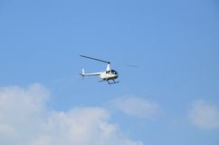 Pleasure lightweight helicopter in flight Royalty Free Stock Photos