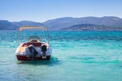 Pleasure motor boat anchored in bay. Of Zakynthos island, Greece Stock Photo