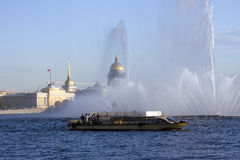 Pleasure motor ship in Neva river on fountain bg Royalty Free Stock Photography