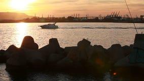 Pleasure motorboat goes on the Black Sea in harbor of Varna stock video