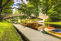 Pleasure motorboats in central public park in Riga, Latvia. Riga is the capital and largest city of Latvia, major cultural, historical and tourist center of Royalty Free Stock Photo