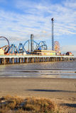 Pleasure Pier amusement park and beach on the Gulf of Mexico coast in Galveston Royalty Free Stock Photo
