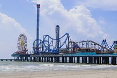 Pleasure Pier on Galveston Island, Texas extends out into the Gulf of Mexico stock photos