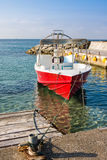 Pleasure red boat at pier in Paphos, Cyprus. Pleasure red boat at the pier in Paphos, Cyprus Royalty Free Stock Image