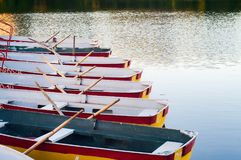 Pleasure rowing boats moored at the pier. stock image