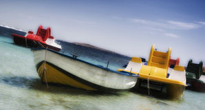 Pleasure rowing boats and pedalos tied up on sardinia caprera Royalty Free Stock Images
