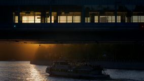 The pleasure ship floats under the bridge. Under the rays of the setting sun stock video footage