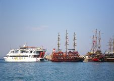 Pleasure ship Mobydick with other yachts on the Mediterranean Sea near 155 beach. Kemer, Turkey stock photography