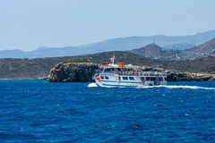 Pleasure ship with tourists on the sea. Royalty Free Stock Image