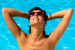 Pleasure of sun in swimming pool Royalty Free Stock Photos