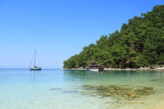 Pleasure to sail!. Boats anchored on the shore of the Aegean Sea Royalty Free Stock Photos