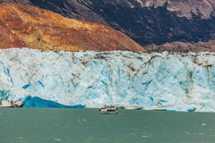 Pleasure tourist boat floats to the glacier Stock Photography